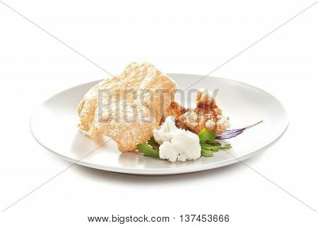 Molecular modern cuisine. Chips Pigskin. Stock image. Isolated on white