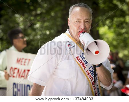 NEW YORK - JUNE 12 2016: New York Senator Chuck Schumer marches in the 59th annual National Puerto Rican Day Parade on 5th Avenue in New York City on June 12 2016.