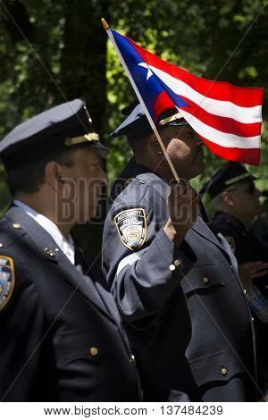 NEW YORK - JUNE 12 2016: Members of the NYPD march in the 59th annual National Puerto Rican Day Parade on 5th Avenue in New York City on June 12 2016.