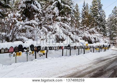 Coeur d' Alene Idaho - December 30: Line of mailboxes set up on the road covered in snow and wintery record conditions December 30 2016 in Coeur d' Alene Idaho