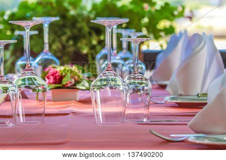 Solemnly Laid Table With Wine Glasses