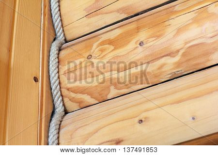 the inner a log cabin corner of the house is built from wooden logs and entwined rope as a background