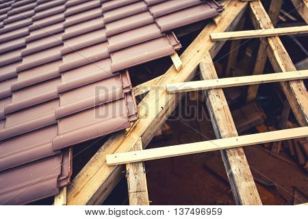 Roof Building With Ceramic Brown Tiles On Wooden, Timber Structure. Geometric Distribution Of Roof T