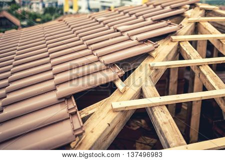 Construction Site Of New House, Roof Building With Brown Tiles And Timber. Contractor Building Roof
