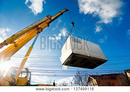 Industrial Crane Operating And Lifting An Electric Generator Aga