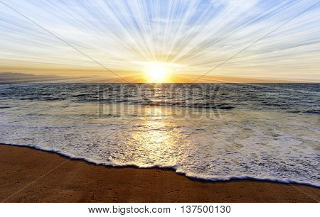 Ocean sunset sun rays is a brightly lit golden orange seascape with a burst of sun beams as a gentle wave rolling to the shore.