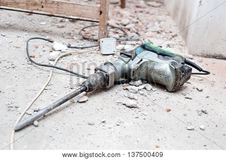 Construction Tool, The Jackhammer With Demolition Debris