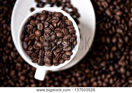 Black, Strong Aromatic Bio African Coffee Beans In A Coffee Cup