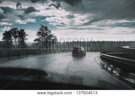 Drive Car In Rain On Curve Asphalt Wet Road