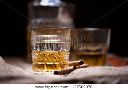 Whiskey Drink On The Rocks With Bottle Isolated On Black