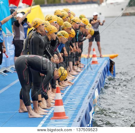 STOCKHOLM - JUL 02 2016: The female swimmers just before the start signal in the Women's ITU World Triathlon series event July 02 2016 in Stockholm Sweden