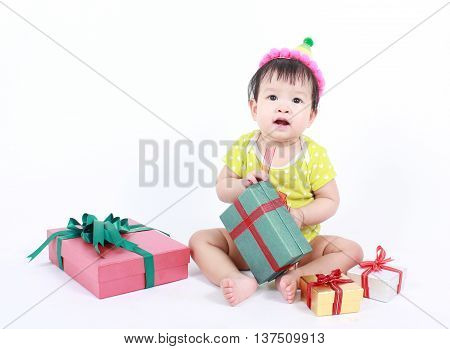 Cute baby laughing wearing party hat, over white background.