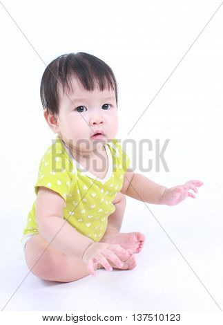 Beautiful child, cute Asian baby on a studio white background