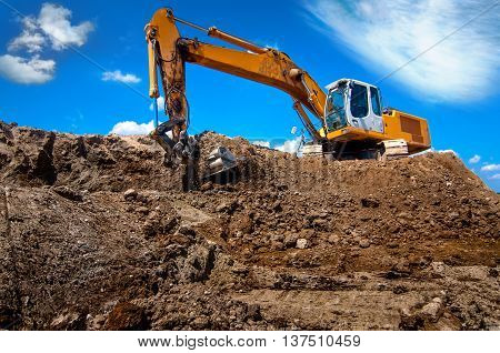 Industrial excavator, bulldozer or heavy machinery working on construction site poster