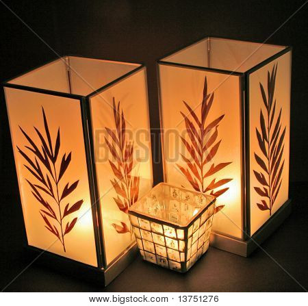 A group of three oriental type candles