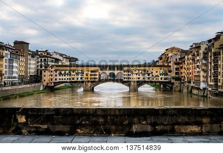 Perspective view of Old Ponte Vecchio Bridge on dull day, Florence, Tuscany region, Italy