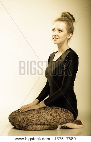 Graceful beautiful woman ballet dancer full length studio shot sepia vintage aged tone