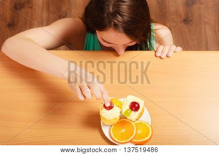 Woman Eating Delicious Sweet Cake. Gluttony.