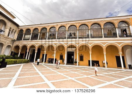 SEVILLE, SPAIN - September 12, 2015: View of the House of Trade (Casa de Contratacion) and the Patio de la Monteria in the Alcazar of Seville on September 12, 2015 in Seville, Spain