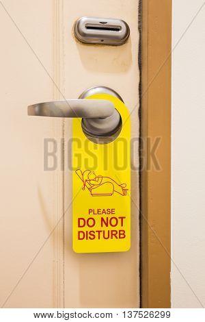 Please do not disturb sign hang on door knob in hotel