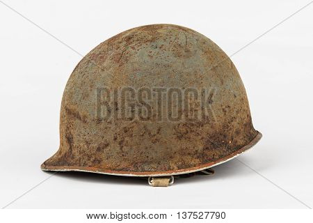 Rusty old vintage military helmet on white background