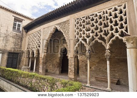 SEVILLE, SPAIN - September 12, 2015: The Almohad Palace seen from the Patio del Yeso in the Alcazar Royal of Seville on September 12, 2015 in Seville, Spain