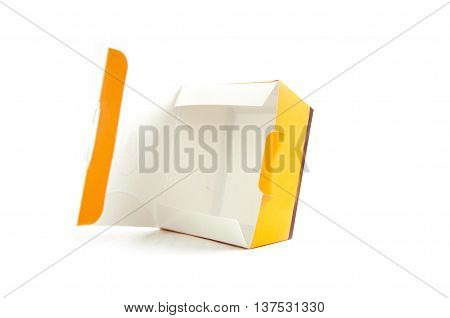 Empty open yellow paper box isolated on white background