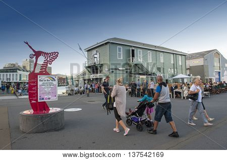 Wellington, New Zealand - March 3 2016: People walking at Wellington waterfront, north island of New Zealand
