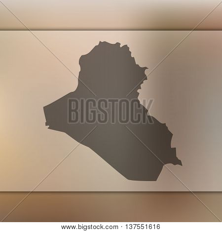 Iraq map on blurred background. Blurred background with silhouette of Iraq. Iraq.