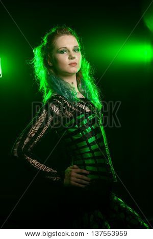Woman In Green Corsait In Fashion Lighting