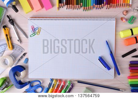 Open Notebook In Center With School Material