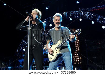 WANTAGH, NY-AUG 14: Eddie Van Halen (R) and David Lee Roth of Van Halen perform onstage at Jones Beach Theater on August 14, 2015 in Wantagh, New York.