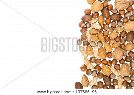 Assorted nuts isolated on white background with place for text. Adverisement, flyer, document template. Natural foods, vegan supplement, healthy fat source. Almonds, walnuts, hazelnuts.