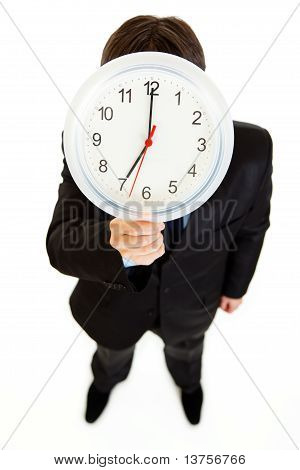 Businessman holding watch in front of face isolated on white