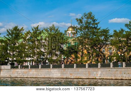 YEKATERINBURG RUSSIA - AUGUST 24 2013. Embankment of the Iset river with walking people and Church on Blood in Honour of All Saints in Yekaterinburg Russia - architecture landscape.