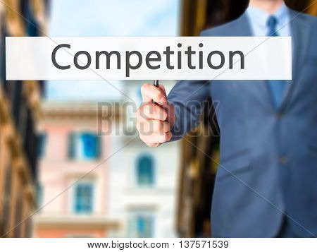 Competition - Business Man Showing Sign