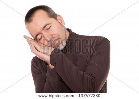a caucasian man is sleeping standing up