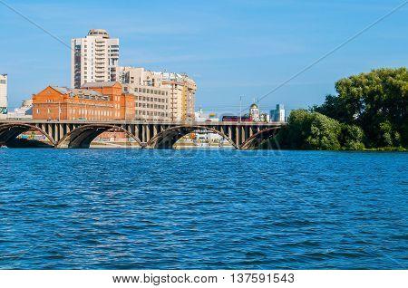 Panorama of Yekaterinburg - modern amd historic buildings along the embankment and Makarov bridge- the longest bridge across the Iset river in Yekaterinburg Russia