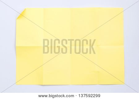 Closeup of creased paper isolated on white background.
