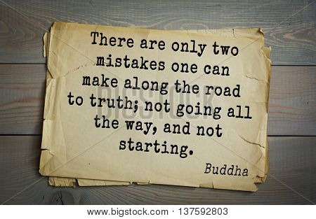 Buddha quote on old paper background. There are only two mistakes one can make along the road to truth; not going all the way, and not starting.
