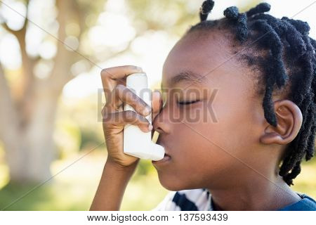 Child holding an object at park