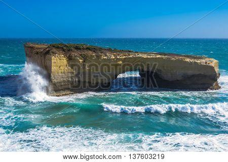 London Bridge rock formation with waves breaking, the Great Ocean Road, Australia