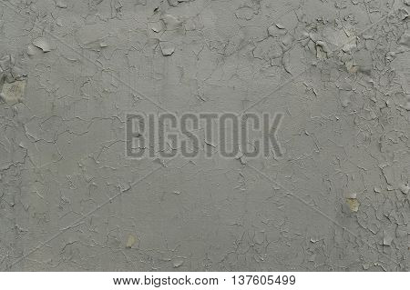 Grey paint texture peeling off the wall
