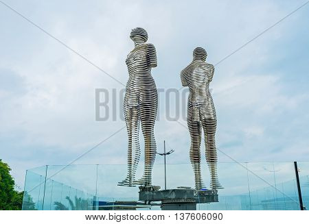 BATUMI GEORGIA - MAY 24 2016: The moving statues of two lovers pass through each other is the philosophical vision of love on May 24 in Batumi.
