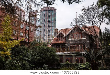 Shanghai China traditional old house building and new modern skyskraper tower