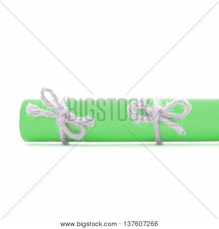 Natural handmade rope knots tied on green message roll isolated