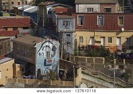 VALPARAISO, CHILE - JULY 5, 2016: Colourfully decorated houses crowd the hillsides of the historic port city of Valparaiso in Chile.