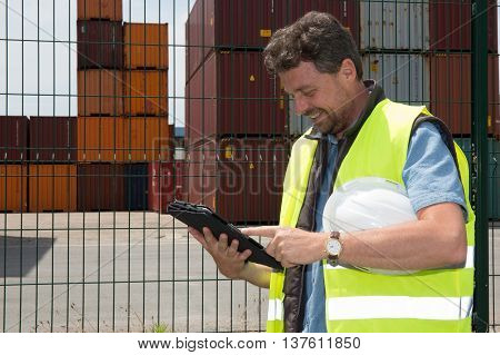 View Of An Attractive Docker Using Tablet At Work