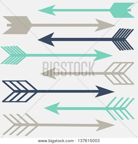 Navy Blue, Teal and grey different shaped arrows on a white background