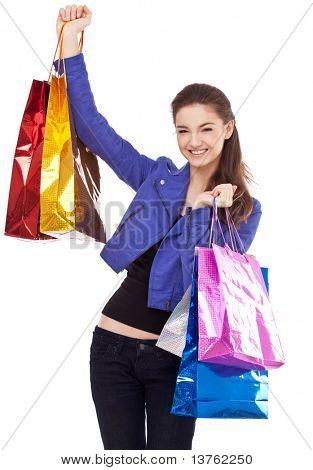 Image of girl with their purchases. Isolated on white background.